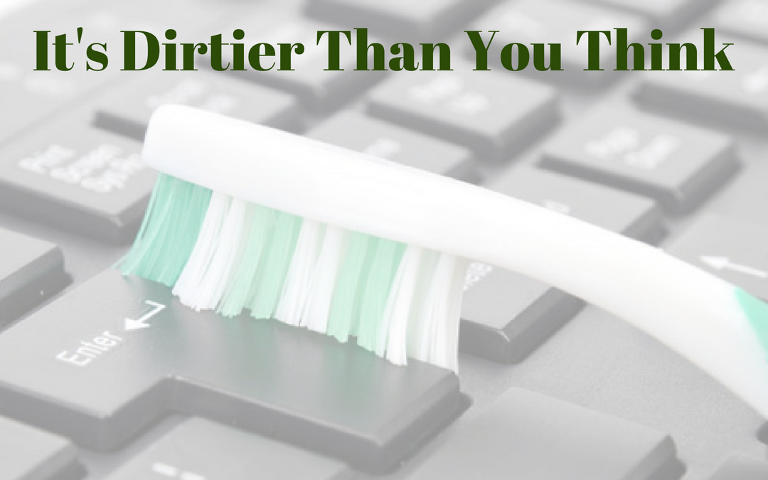 """keyboard with a toothbrush to clean it. Title says """"It's Dirtier Than You Think"""""""